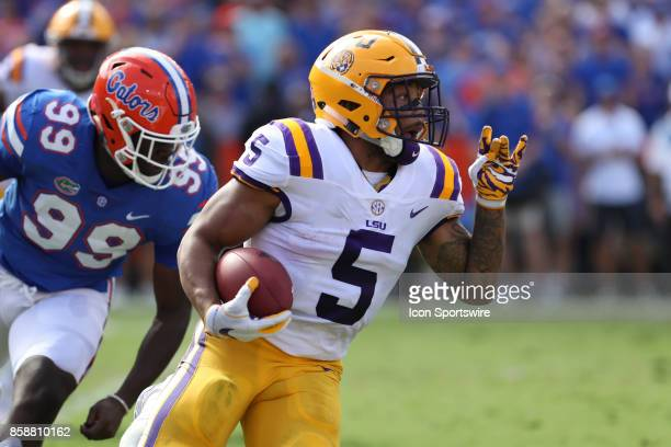 Tigers running back Derrius Guice runs with the ball in the 1st quarter of the college football game between the LSU Tigers and Florida Gators on...