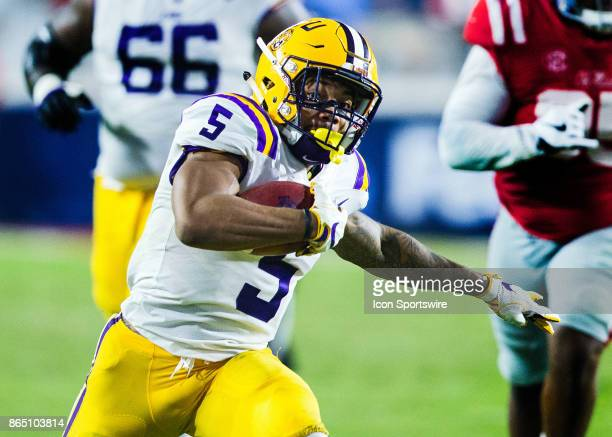 Tigers running back Derrius Guice rushes the ball during a football game between the LSU Tigers and Ole Miss Bears at Vaught Hemingway Stadium in...