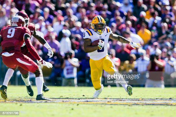 Tigers running back Derrius Guice rushes the ball during a game between the Arkansas Razorbacks and the LSU Tigers at Tiger Stadium in Baton Rouge...