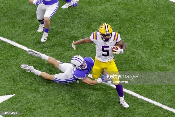Tigers running back Derrius Guice slips a tackle during the AdvoCare Texas Kickoff BYU v LSU on SEP 02 2017 at MercedesBenz Superdome in New Orleans...