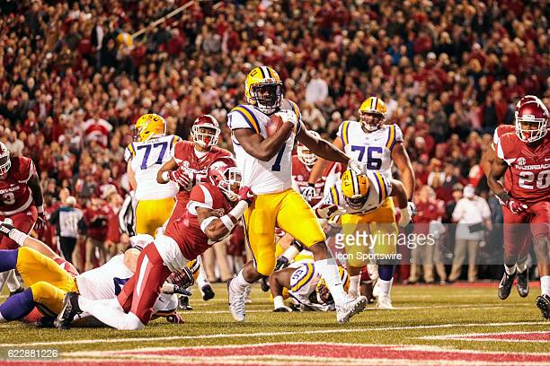 Tigers running back Leonard Fournette scores a touchdown as Arkansas Razorbacks linebacker De'Jon Harris during an NCAA football game between the...