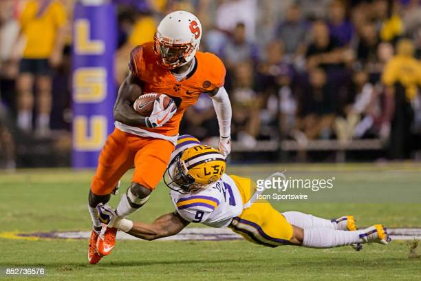 Tigers safety Grant Delpit tackles Syracuse Orange wide receiver Steve Ishmael during a college football game between the LSU Tigers and the Syracuse...
