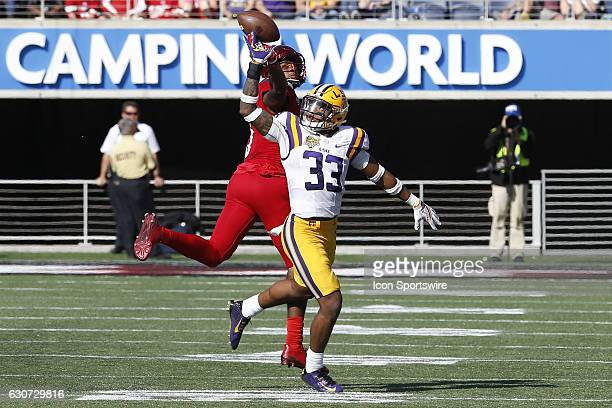Tigers safety Jamal Adams breaks up a pass intended for Louisville Cardinals wide receiver Seth Dawkins in the 4th quarter of the 2016 Buffalo Wild...