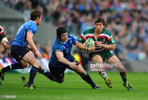 Tigers scrum half Ben Youngs speeds past Mike Ross of Leinster during the Heineken Cup Quarter Final match between Leinster and Leicester Tigers at...
