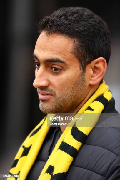 Tigers supporter Waleed Aly looks on during a Richmond Tigers AFL training session at Punt Road Oval on September 21 2017 in Melbourne Australia