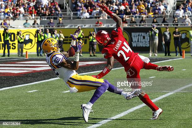 Tigers wide receiver DJ Chark catches a pass as he falls backwards well being covered by Louisville Cardinals cornerback Zykiesis Cannon in the 2nd...