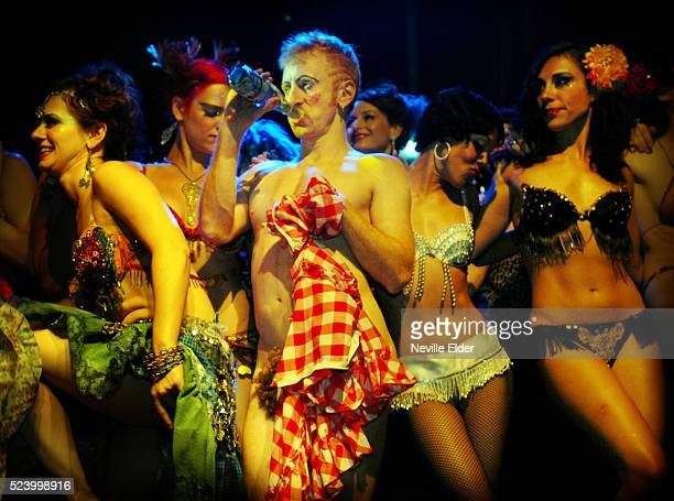 Tigger takes a drink as Performers take a bow at the end of The 5th Annual New York Burlesque Festival at the Highline Ballroom New York City USA