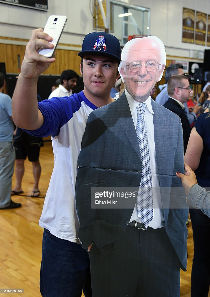 Tighe Galvin of Nevada takes a selfie with a cardboard cutout of Democratic presidential candidate Sen. Bernie Sanders (I-VT) while waiting for him to speak at a campaign rally at Bonanza High School on February 14, 2016 in Las Vegas, Nevada. Sanders is challenging Hillary Clinton for the Democratic presidential nomination ahead of Nevada's Feb. 20 Democratic caucus.