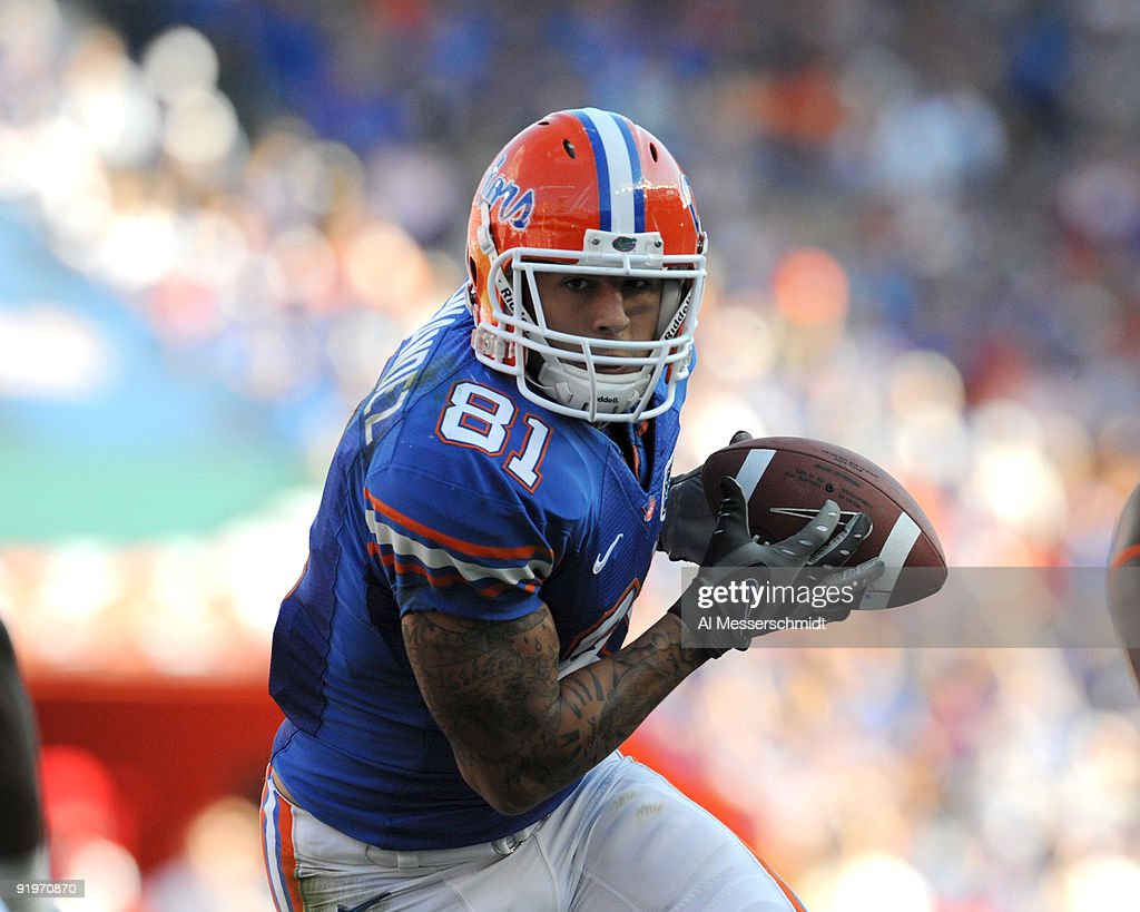Tight end Aaron Hernandez of the Arkansas Razorbacks rushes upfield with a pass against the Florida Gators October 17 2009 at Ben Hill Griffin...