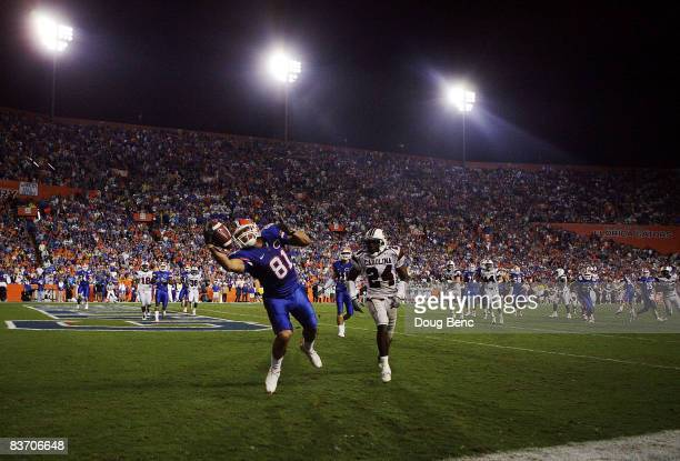 Tight end Aaron Hernandez of the Florida Gators catches a fourth quarter touchdown pass over safety Darian Stewart of the South Carolina Gamecocks at...