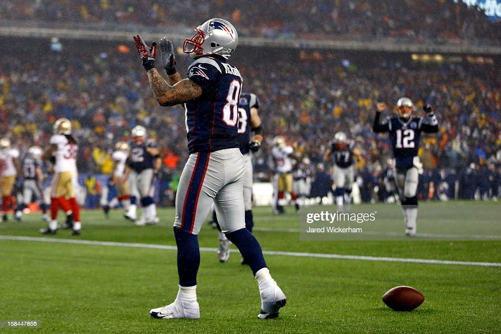 Tight end <a gi-track='captionPersonalityLinkClicked' href=/galleries/search?phrase=Aaron+Hernandez+-+American+Football+Player&family=editorial&specificpeople=4586516 ng-click='$event.stopPropagation()'>Aaron Hernandez</a> #81 of the New England Patriots celebrates after scoring a touchdown thrown by quarterback <a gi-track='captionPersonalityLinkClicked' href=/galleries/search?phrase=Tom+Brady+-+American+Football+Quarterback&family=editorial&specificpeople=201737 ng-click='$event.stopPropagation()'>Tom Brady</a> #12 of the New England Patriots in the fourth quarter against the San Francisco 49ers at Gillette Stadium on December 16, 2012 in Foxboro, Massachusetts.