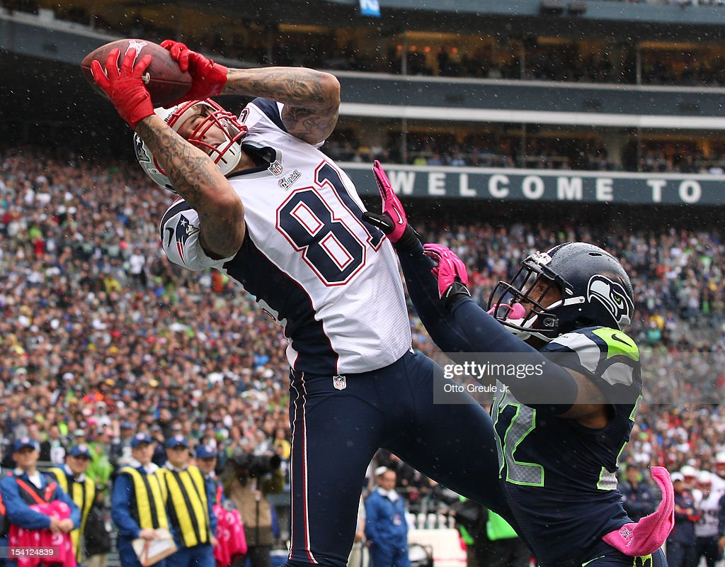 Tight end Aaron Hernandez of the New England Patriots makes a touchdown catch against defensive back Jeron Johnson of the Seattle Seahawks at...
