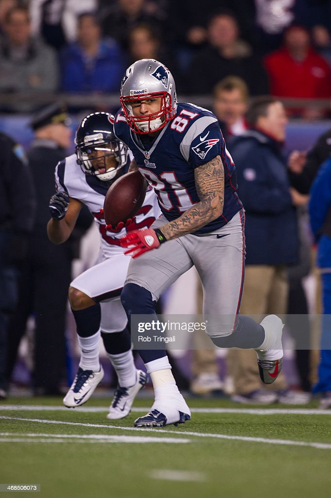 Tight End Aaron Hernandez of the New England Patriots runs the ball during the AFC Divisional Playoff against the Houston Texans at Gillette Stadium...