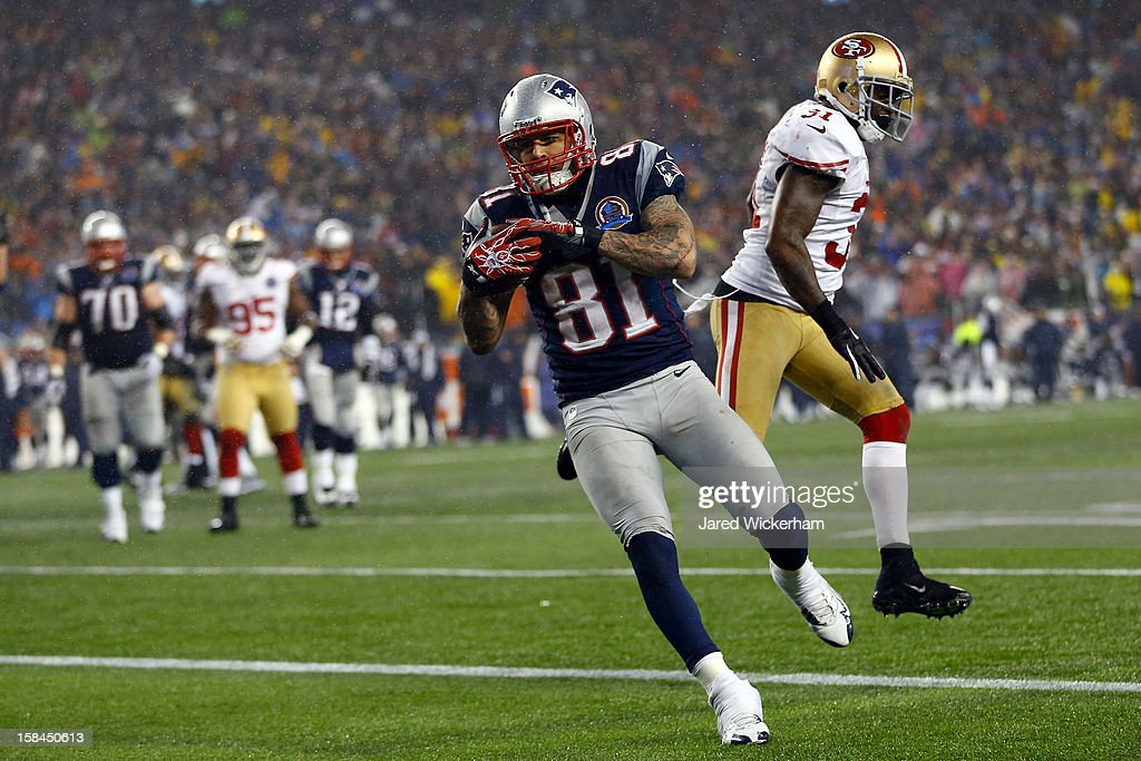Tight end Aaron Hernandez of the New England Patriots scores a touchdown thrown by quarterback Tom Brady of the New England Patriots in the fourth...