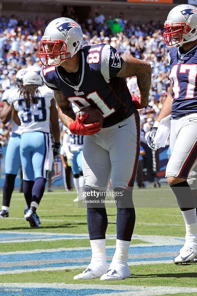 Tight end Aaron Hernandez of the New England Patriots takes a bow after scoring a touchdown against the Tennessee Titans during their season opener...