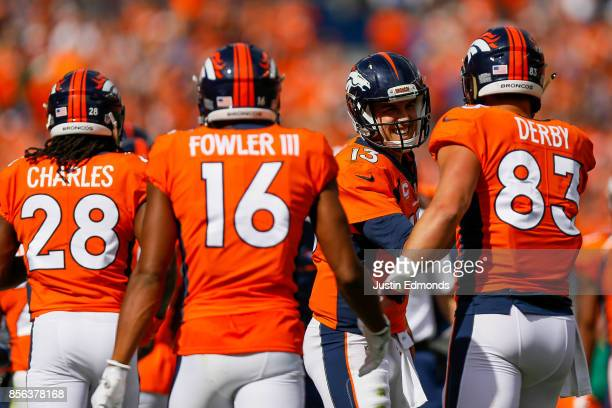 Tight end AJ Derby of the Denver Broncos celebrates with Trevor Siemian after scoring a touchdown in the first quarter of a game against the Oakland...