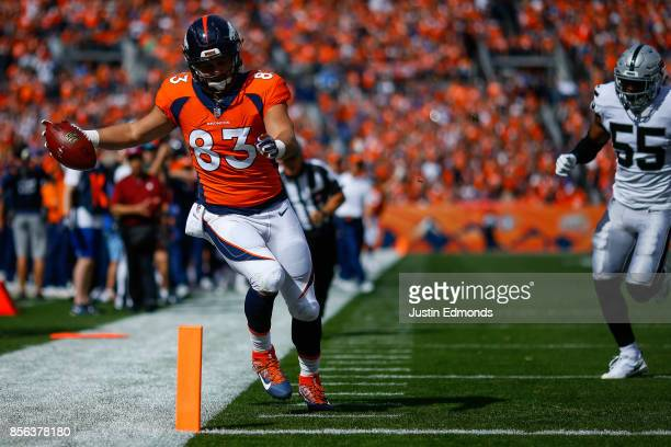 Tight end AJ Derby of the Denver Broncos crosses the goal line for a touchdown in the first quarter of a game against the Oakland Raiders at Sports...