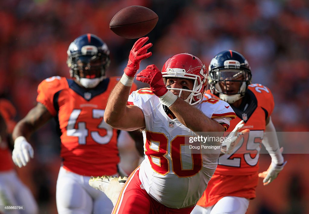 Tight end Anthony Fasano #80 of the Kansas City Chiefs makes a pass reception against strong safety T.J. Ward #43 and cornerback Chris Harris #25 of the Denver Broncos at Sports Authority Field at Mile High on September 14, 2014 in Denver, Colorado. The Broncos defeated the Chiefs 24-17.