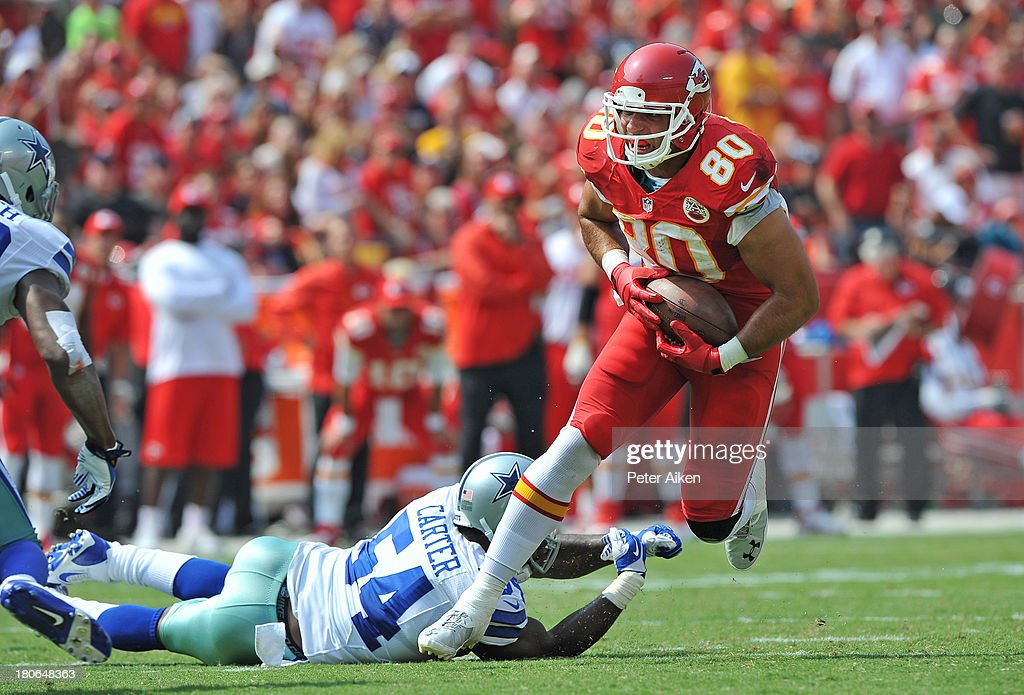 Tight end <a gi-track='captionPersonalityLinkClicked' href=/galleries/search?phrase=Anthony+Fasano&family=editorial&specificpeople=620269 ng-click='$event.stopPropagation()'>Anthony Fasano</a> #80 of the Kansas City Chiefs rushes past linebacker Bruce Carter #54 of the Dallas Cowboys during the second half on September 15, 2013 at Arrowhead Stadium in Kansas City, Missouri. Kansas City defeated Dallas 17-16.