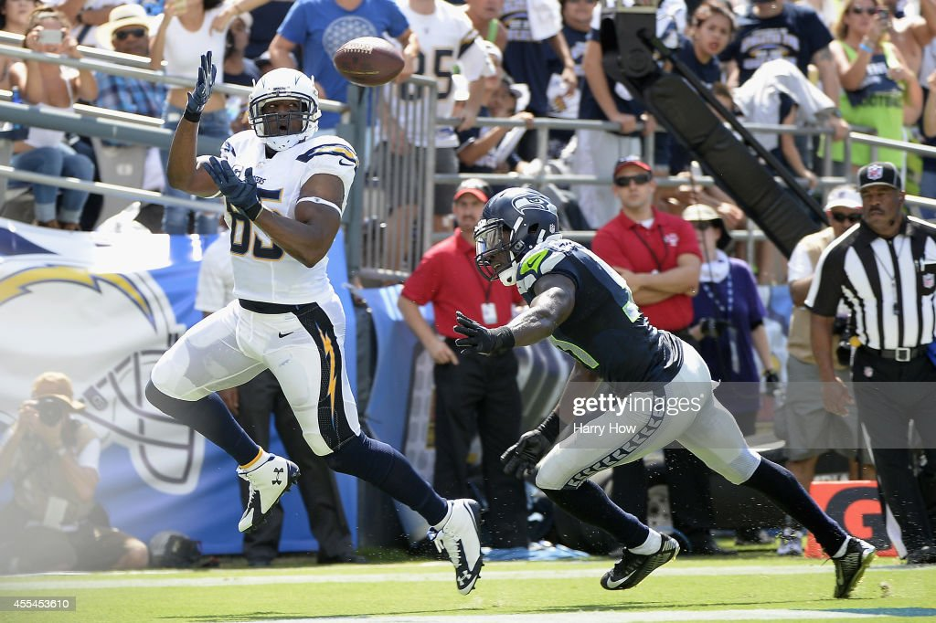 Tight end Antonio Gates #85 of the San Diego Chargers catches a pass for a touchdown while defended by strong safety Kam Chancellor #31 of the Seattle Seahawks at Qualcomm Stadium on September 14, 2014 in San Diego, California.