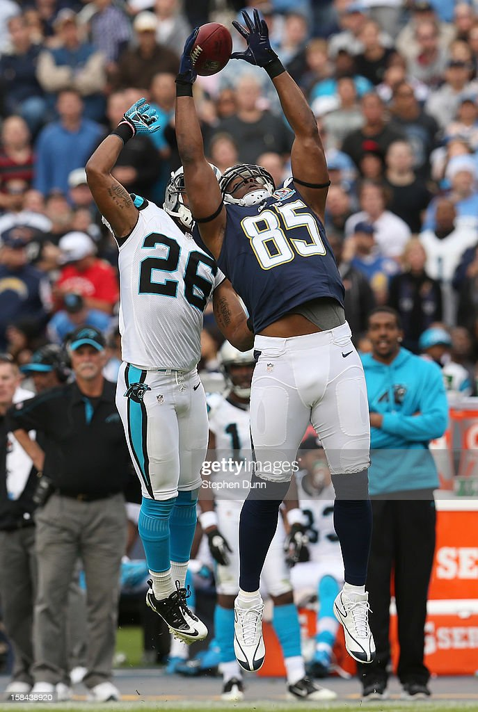 Tight end <a gi-track='captionPersonalityLinkClicked' href=/galleries/search?phrase=Antonio+Gates&family=editorial&specificpeople=184491 ng-click='$event.stopPropagation()'>Antonio Gates</a> of the San Diego Chargers jumps but can't make the catch in front of safety D.J. Campbell #26 of the Carolina Panthers at Qualcomm Stadium on December 16, 2012 in San Diego, California. The Panthers won 31-7.