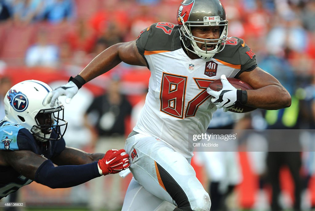 Tight end Austin Seferian-Jenkins #87 of the Tampa Bay Buccaneers runs for a 42-yard touchdown reception against the Tennessee Titans in the fourth quarter at Raymond James Stadium on September 13, 2015 in Tampa, Florida.
