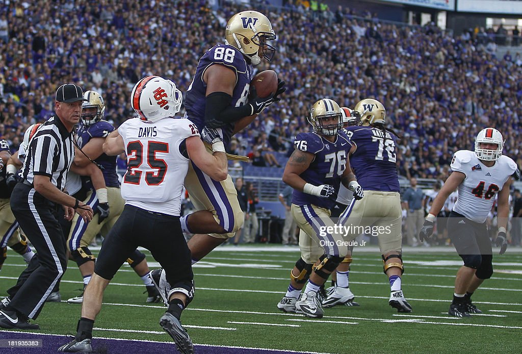 Tight end Austin Seferian-Jenkins #88 of the Washington Huskies makes a catch for a touchdown against defensive back Tanner Davis #25 of the Idaho State Bengals on September 21, 2013 at Husky Stadium in Seattle, Washington.