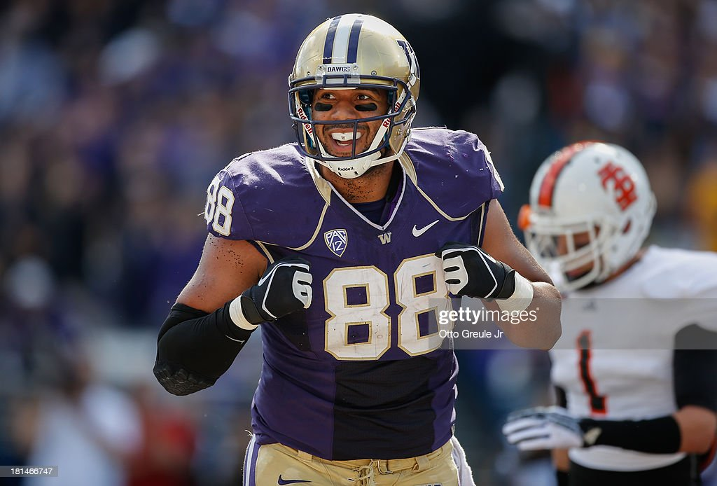 Tight end Austin Seferian-Jenkins #88 of the Washington Huskies reacts after making a catch to set up a first and goal against the Idaho State Bengals on September 21, 2013 at Husky Stadium in Seattle, Washington.