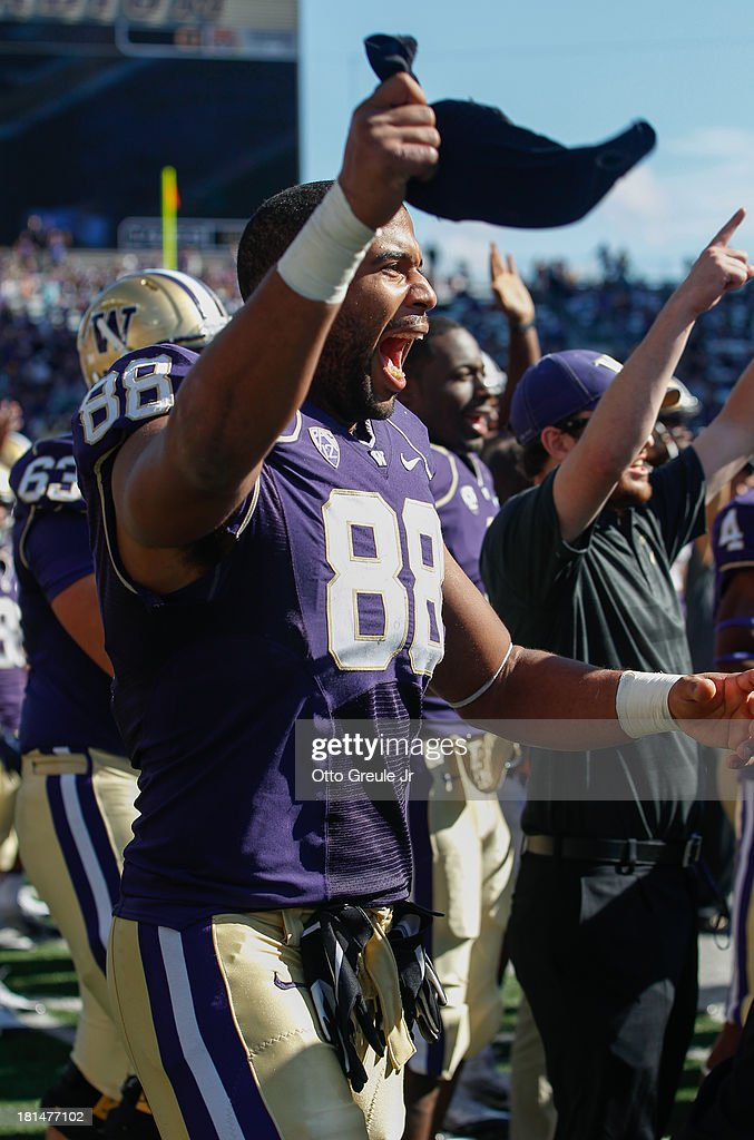 Tight end Austin Seferian-Jenkins #88 of the Washington Huskies reacts to a touchdown scored by Deontae Cooper in the fourth quarter against the Idaho State Bengals on September 21, 2013 at Husky Stadium in Seattle, Washington. The Huskies defeated the Bengals 56-0.