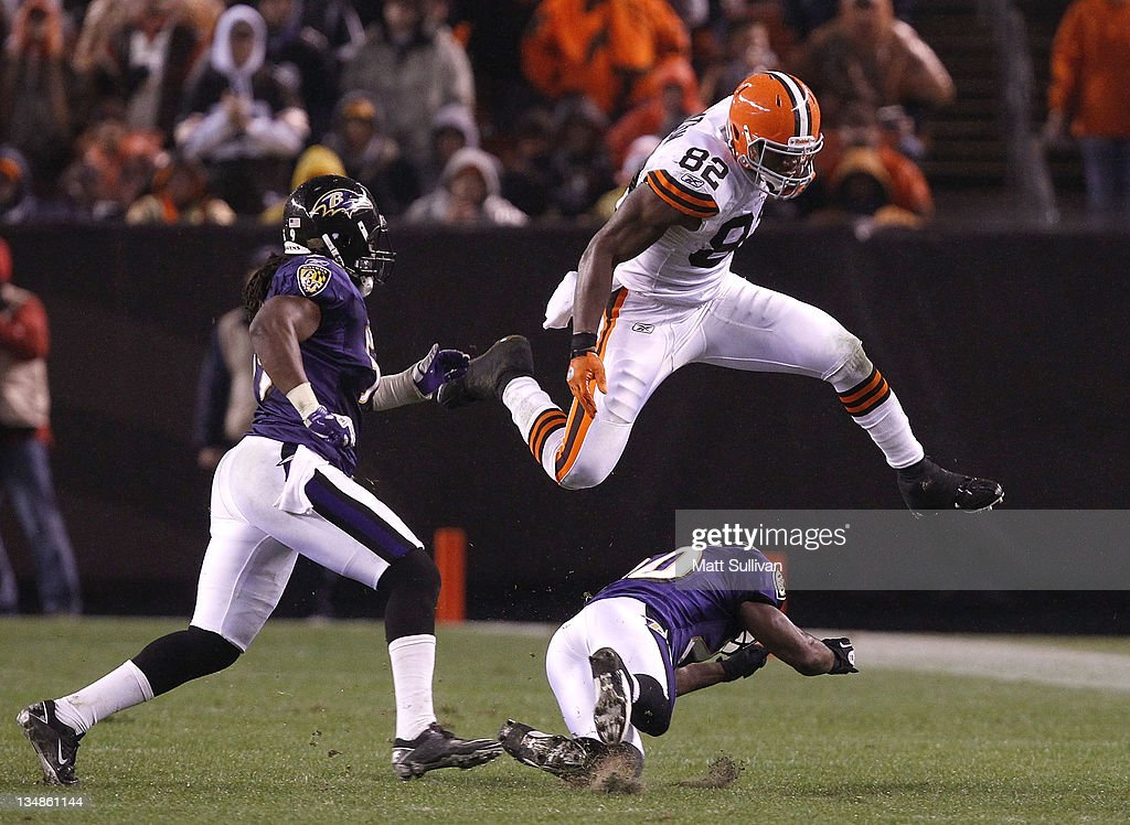 Tight end <a gi-track='captionPersonalityLinkClicked' href=/galleries/search?phrase=Benjamin+Watson+-+American+Football+Player&family=editorial&specificpeople=15154817 ng-click='$event.stopPropagation()'>Benjamin Watson</a> #82 of the Cleveland Browns jumps over safety <a gi-track='captionPersonalityLinkClicked' href=/galleries/search?phrase=Ed+Reed&family=editorial&specificpeople=194933 ng-click='$event.stopPropagation()'>Ed Reed</a> #20 of the Baltimore Ravens before being hit by linebacker Dannell Ellerbe #59 at Cleveland Browns Stadium on December 4, 2011 in Cleveland, Ohio.