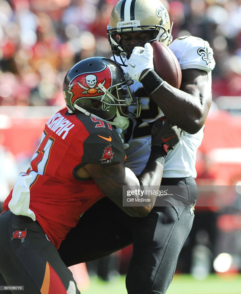Tight end <a gi-track='captionPersonalityLinkClicked' href=/galleries/search?phrase=Benjamin+Watson+-+American+Football+Player&family=editorial&specificpeople=15154817 ng-click='$event.stopPropagation()'>Benjamin Watson</a> #82 of the New Orleans Saints is tackled by outside linebacker <a gi-track='captionPersonalityLinkClicked' href=/galleries/search?phrase=Danny+Lansanah&family=editorial&specificpeople=5442040 ng-click='$event.stopPropagation()'>Danny Lansanah</a> #51 of the Tampa Bay Buccaneers in the first quarter at Raymond James Stadium on December 13, 2015 in Tampa, Florida.
