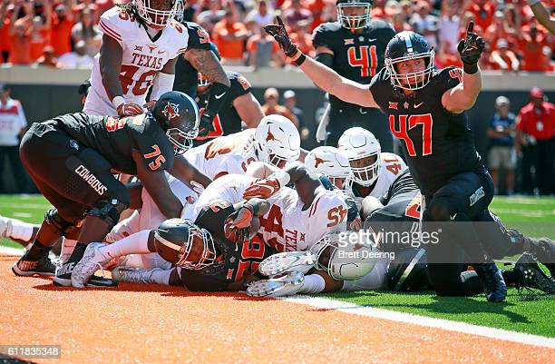 Tight end Blake Jarwin reacts to running back Barry J Sanders of the Oklahoma State Cowboys touchdown against the Texas Longhorns October 1 2016 at...