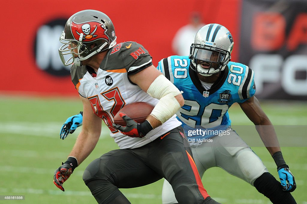 Tight end Brandon Myers #82 of the Tampa Bay Buccaneers runs against cornerback <a gi-track='captionPersonalityLinkClicked' href=/galleries/search?phrase=Antoine+Cason&family=editorial&specificpeople=2803078 ng-click='$event.stopPropagation()'>Antoine Cason</a> #20 of the Carolina Panthers at Raymond James Stadium on September 7, 2014 in Tampa, Florida. (Photo by Cliff McBride/Getty Images) )