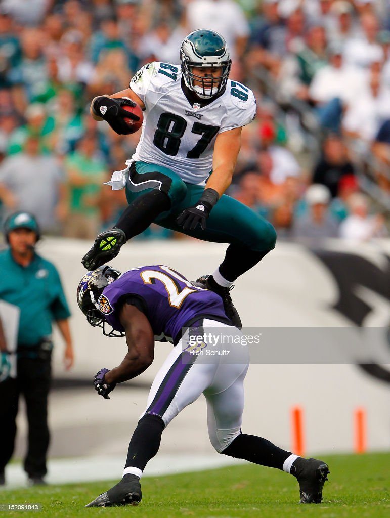 Tight end <a gi-track='captionPersonalityLinkClicked' href=/galleries/search?phrase=Brent+Celek&family=editorial&specificpeople=2557212 ng-click='$event.stopPropagation()'>Brent Celek</a> #87 of the Philadelphia Eagles leaps over safety <a gi-track='captionPersonalityLinkClicked' href=/galleries/search?phrase=Ed+Reed+-+American+Football+Player&family=editorial&specificpeople=194933 ng-click='$event.stopPropagation()'>Ed Reed</a> #20 for a first down in the third quarter during a game at Lincoln Financial Field on September 16, 2012 in Philadelphia, Pennsylvania. The Eagles defeated the Ravens 24-23.