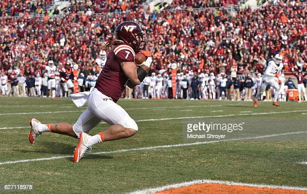 Tight end Bucky Hodges of the Virginia Tech Hokies catches a touchdown pass against the Virginia Cavaliers in the second half at Lane Stadium on...