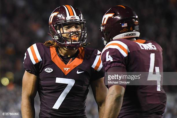 Tight end Bucky Hodges of the Virginia Tech Hokies celebrates his touchdown reception with quarterback Jerod Evans in the first half against the...