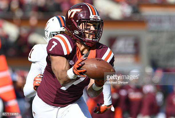 Tight end Bucky Hodges of the Virginia Tech Hokies has a reception go through his hands in the first half against the Virginia Cavaliers at Lane...
