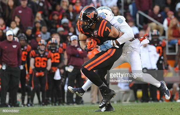Tight end Bucky Hodges of the Virginia Tech Hokies is hit following his reception by cornerback MJ Stewart of the North Carolina Tar Heels in the...