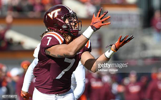 Tight end Bucky Hodges of the Virginia Tech Hokies watches the incoming pass against the Virginia Cavaliers in the first half at Lane Stadium on...