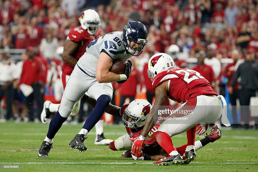 Tight end Chase Coffman #86 of the Seattle Seahawks runs with the football after a reception during the NFL game at the University of Phoenix Stadium on January 3, 2016 in Glendale, Arizona. The Seahawks defeated the Cardinals 36-6.