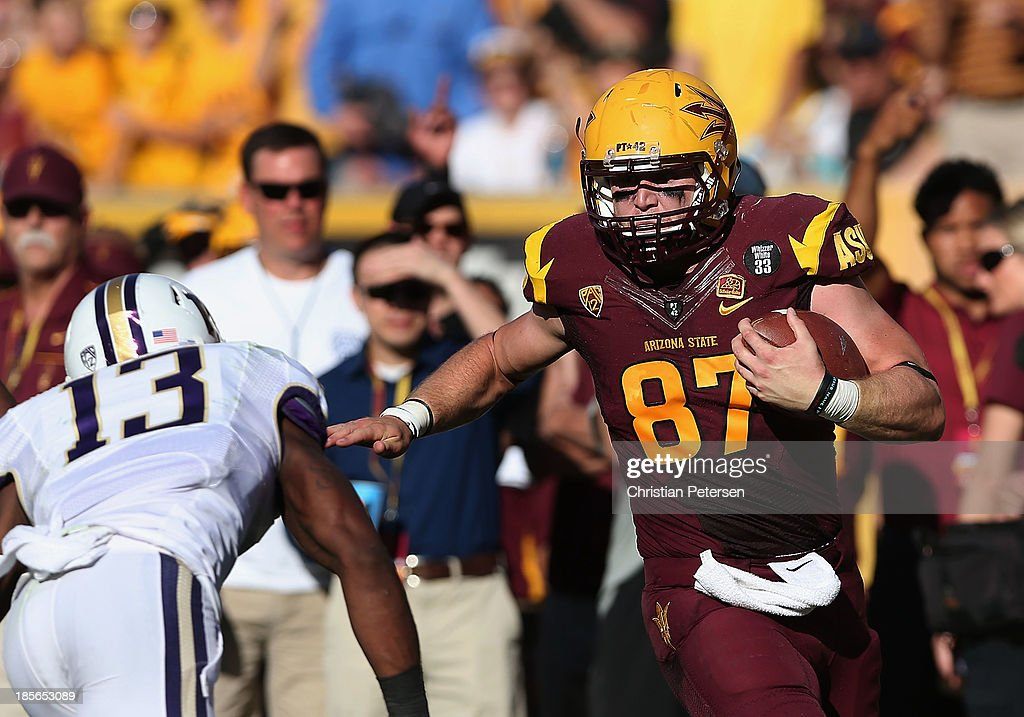 Tight end Chris Coyle #87 of the Arizona State Sun Devils runs with the football after a reception against the Washington Huskies during the college football game at Sun Devil Stadium on October 19, 2013 in Tempe, Arizona. The Sun Devils defeated the Huskies 53-24.