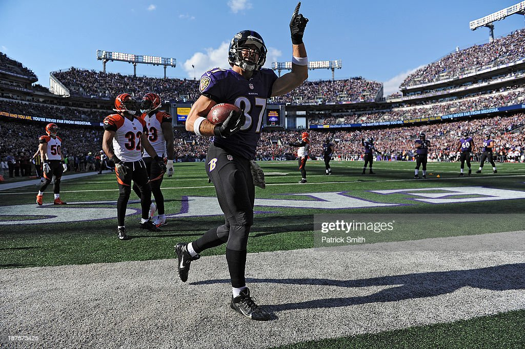 Tight end <a gi-track='captionPersonalityLinkClicked' href=/galleries/search?phrase=Dallas+Clark&family=editorial&specificpeople=184501 ng-click='$event.stopPropagation()'>Dallas Clark</a> #87 of the Baltimore Ravens celebrates after scoring a touchdown against the Cincinnati Bengals in the first quarter at M&T Bank Stadium on November 10, 2013 in Baltimore, Maryland.