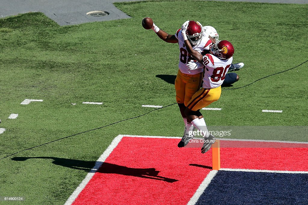 Tight end Daniel Imatorbhebhe #88 celebrates his touchdown with wide receiver Deontay Burnett #80 of the USC Trojans during the second quarter of the college football game against the Arizona Wildcats at Arizona Stadium on October 15, 2016 in Tucson, Arizona.