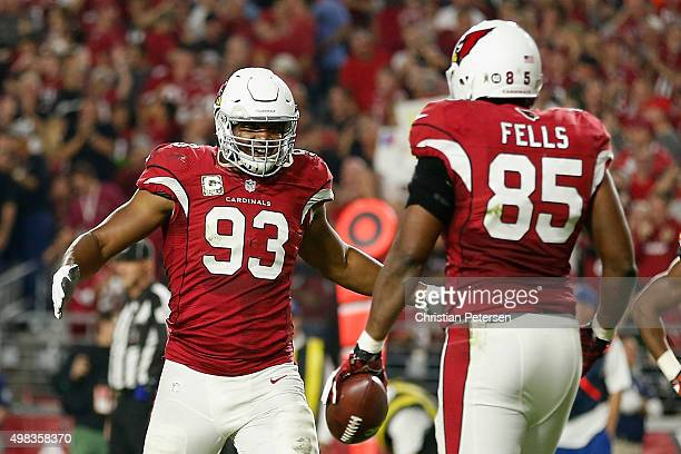 Tight end Darren Fells of the Arizona Cardinals celebrates a second quarter touchdown with defensive end Calais Campbell during the NFL game against...