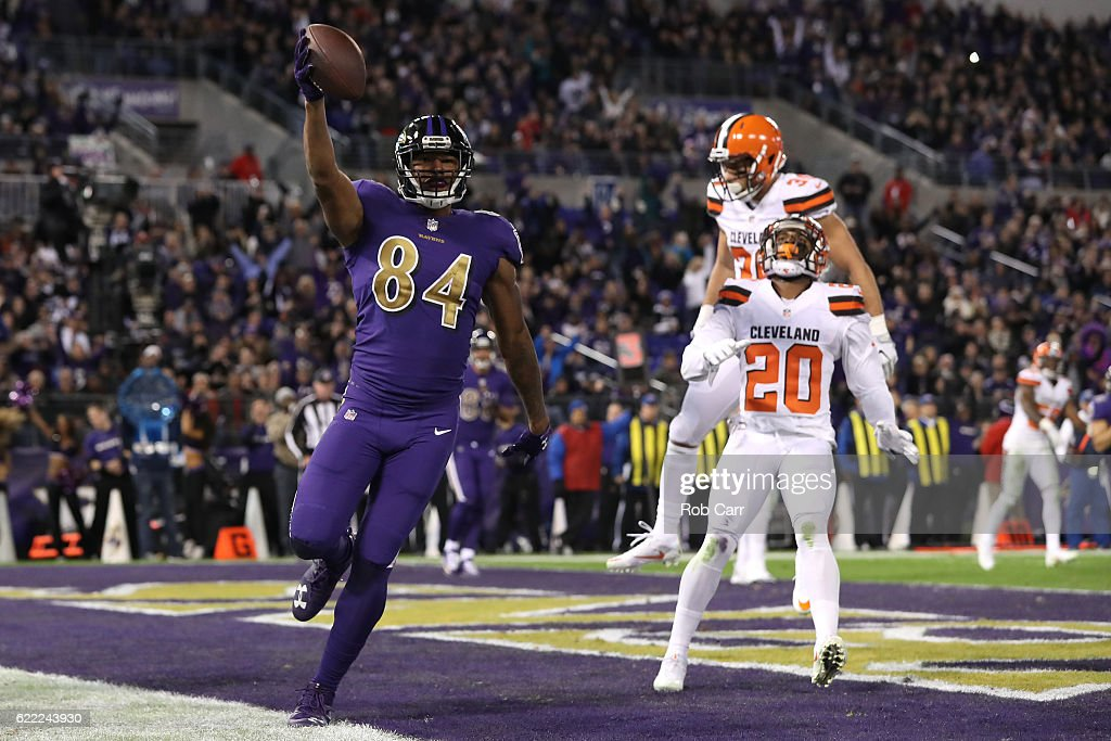Tight end Darren Waller #84 of the Baltimore Ravens scores a third quarter touchdown past cornerback Briean Boddy-Calhoun #20 and defensive back Ed Reynolds #39 of the Cleveland Browns at M&T Bank Stadium on November 10, 2016 in Baltimore, Maryland.