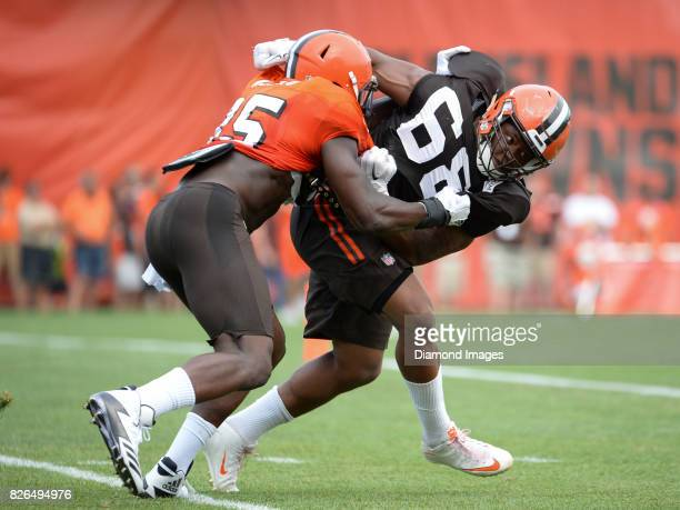 Tight end David Njoku and defensive lineman Jamal Marcus of the Cleveland Browns engage during a training camp practice on August 2 2017 at the...