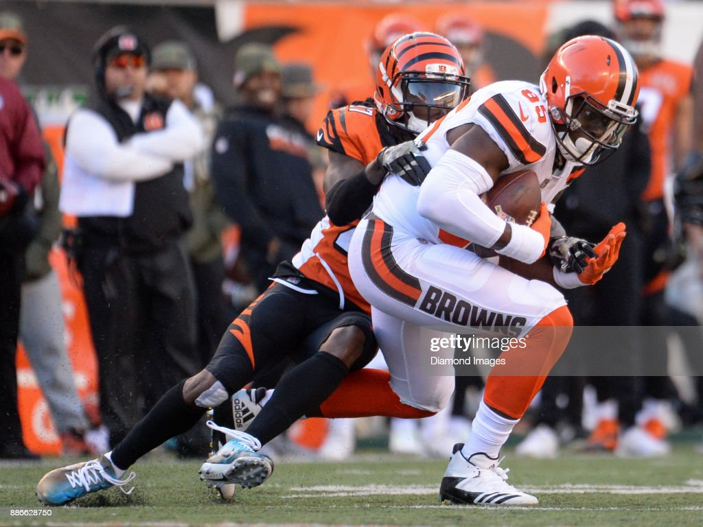 Tight end David Njoku #85 of the Cleveland Browns is tackled by safety Josh Shaw #26 of the Cincinnati Bengals in the fourth quarter of a game on November 26, 2017 at Paul Brown Stadium in Cincinnati, Ohio. Cincinnati won 30-16.