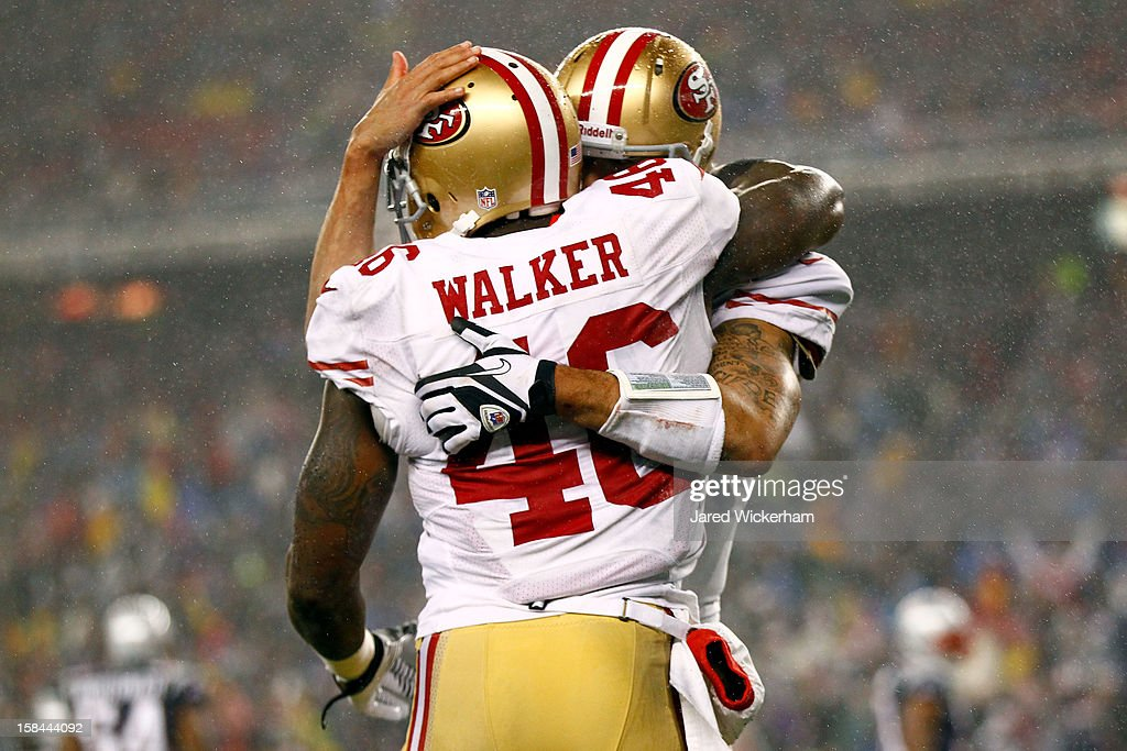 Tight end <a gi-track='captionPersonalityLinkClicked' href=/galleries/search?phrase=Delanie+Walker&family=editorial&specificpeople=618377 ng-click='$event.stopPropagation()'>Delanie Walker</a> #46 of the San Francisco 49ers celebrates a touchdown pass from quarterback <a gi-track='captionPersonalityLinkClicked' href=/galleries/search?phrase=Colin+Kaepernick&family=editorial&specificpeople=5525694 ng-click='$event.stopPropagation()'>Colin Kaepernick</a> #7 in the second quarter against the New England Patriots at Gillette Stadium on December 16, 2012 in Foxboro, Massachusetts.