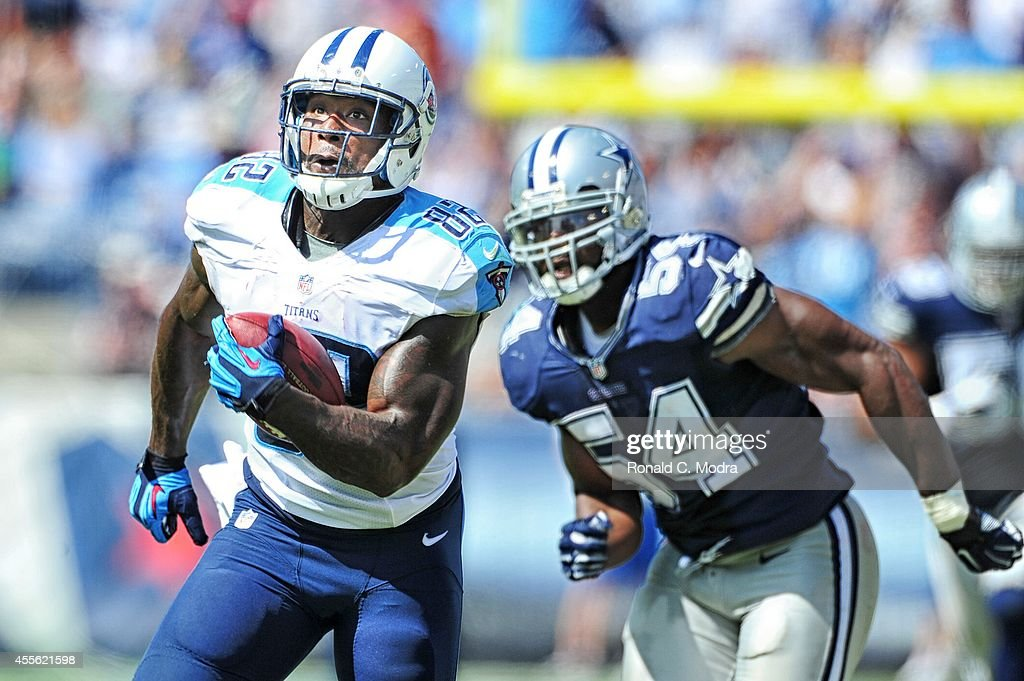 Tight end Delanie Walker of the Tennessee Titans carries the ball during a NFL game against the Dallas Cowboys at LP Field on September 14 2014 in...
