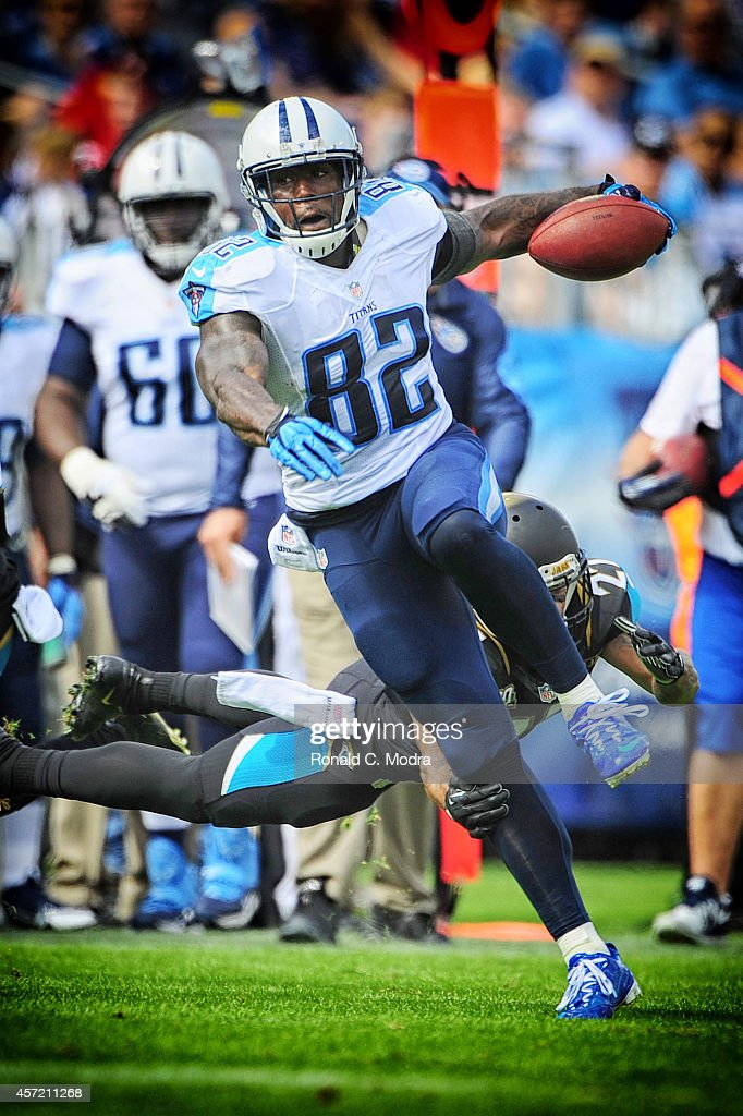 Tight end Delanie Walker of the Tennessee Titans carries the ball during a NFL game against the Jacksonville Jaguars at LP Field on October 12 2014...